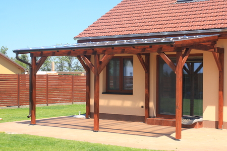 Wooden pergola with a covering of transparent polycarbonate