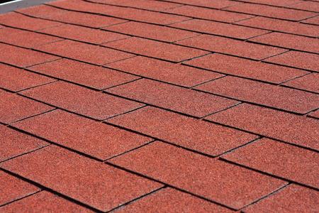 roof shingles: Professionally laid red asphalt shingle rectangular shape on the roof pergola