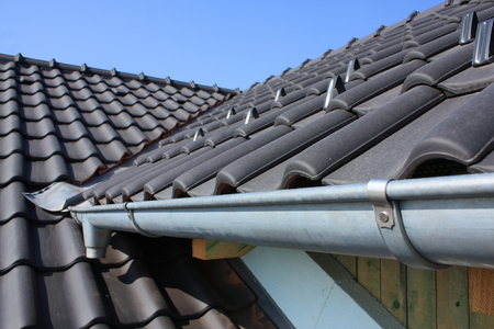 roof texture: The roof is covered with black roofs of clay tiles