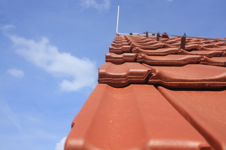 marginal: The new roof is covered with red clay tiles with a lightning rod and marginal roof tiles