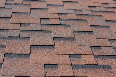 professionally: Professionally laid asphalt shingle rectangular shape on the roof house Stock Photo