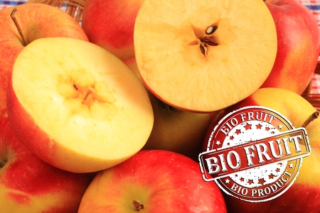 red apples: Red apples with a stamp - bio fruit, bio product Stock Photo