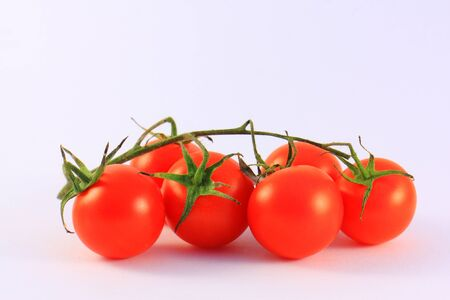 Red cherry tomatoes on a white background Reklamní fotografie