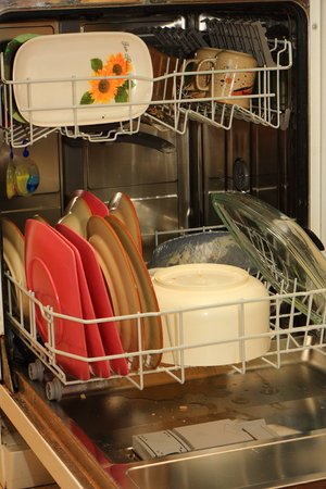 United dishwasher full of dirty dishes to wash  Reklamní fotografie