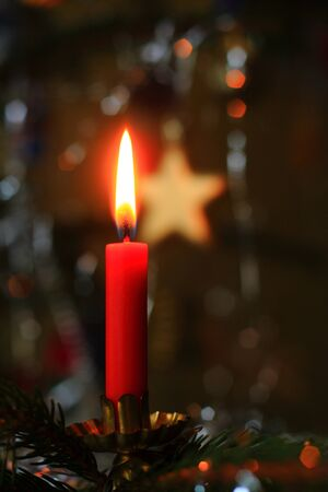 Christmas tree with red candle and star on background Reklamní fotografie