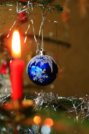 Christmas tree with red and blue candle bulb