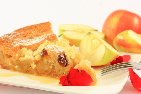 Baked apple pie on a white plate with a fork Reklamní fotografie
