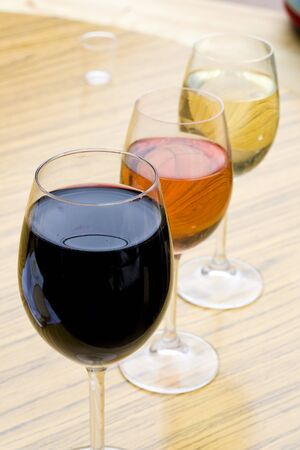 Three glasses of wine in red, pink and white color Stock Photo