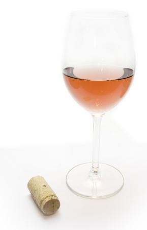 Wine corks and glass of red wine Stock Photo