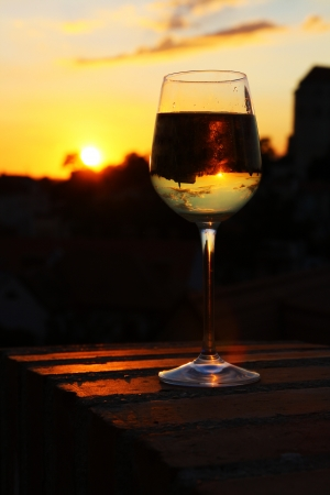 glass of wine in front of sunset