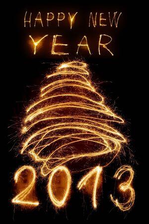 Sparkler new year background in brown