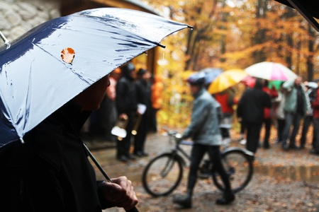 Rainy weather with umbrella and cyclist