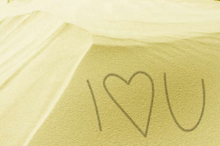 Heart drawn in the white sand