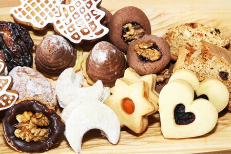 Christmas cookies in wooden plate photo