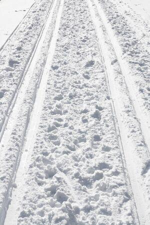 Ski track in white snow