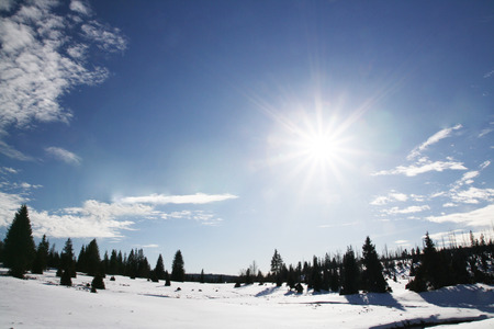 crossings: Winter sunny day in mountains Stock Photo