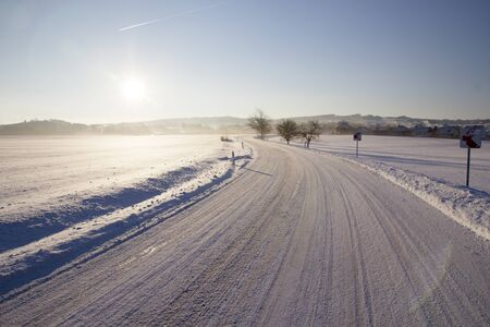Scenic view of empty road with snow