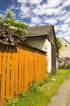 Old rural house in summer sunny day Archivio Fotografico - 128382808