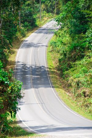 aisa: Empty road with a steep climb in the park