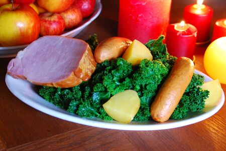 curly leafed: curly-kale with sausage  Stock Photo