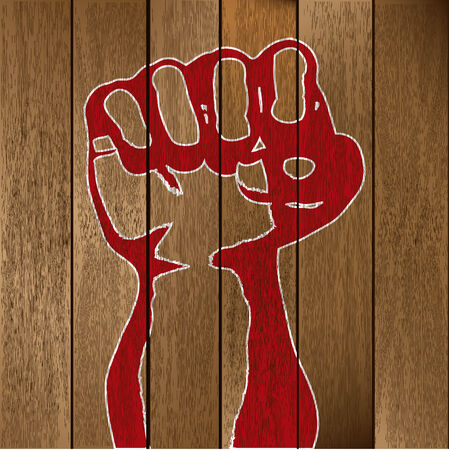 fist clenched: Fist on wooden planks