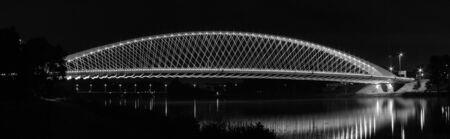 Illuminated bridge over the river