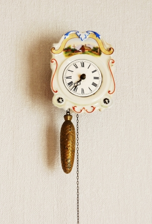 Clock with hanging weights photo