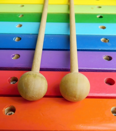 a colorful, wooden xylophone with mallet  Standard-Bild