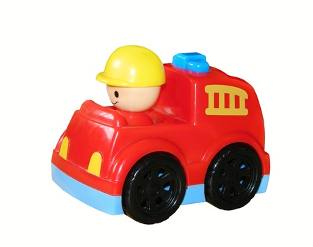 plactic: Red fire engine toy isolated over a white background
