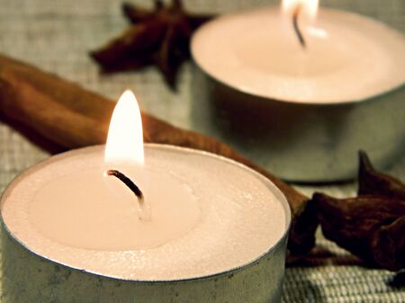 Candle, cinnamon sticks and anise stars photo