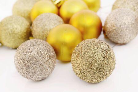 Golden christmas balls on white background