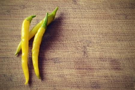Yellow chili pepper on wooden  Standard-Bild
