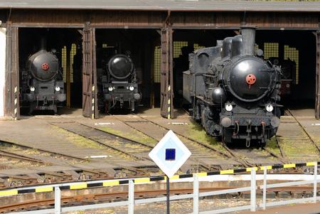 depot: Old Vintage Steam Locomotives At The Train Depot