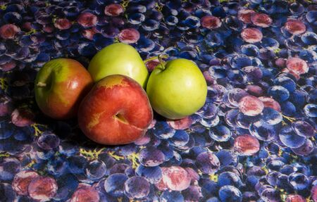 Colorful fruits on designed background apples and peach Banco de Imagens