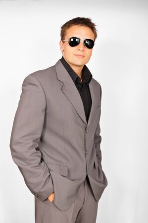Young attractive man with sunglasses in suit