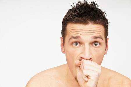 colds: Young man has a cough. You can write text on left side. Stock Photo