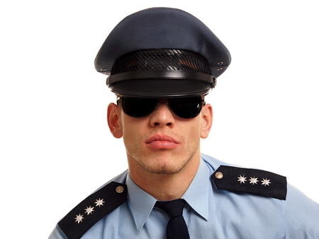 Portrait of policeman at shirt and tie with sunglasses on white background