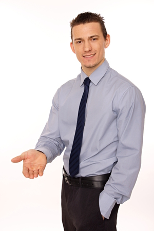 young man with shirt and tie sets his hand