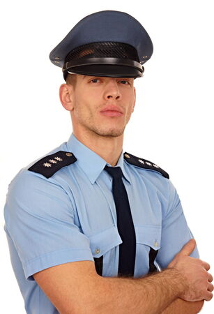 Portrait of young policeman on white background