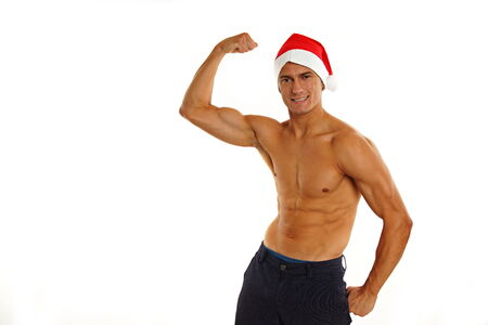 Atletic sexy Santa Claus shows biceps on white backgroung photo
