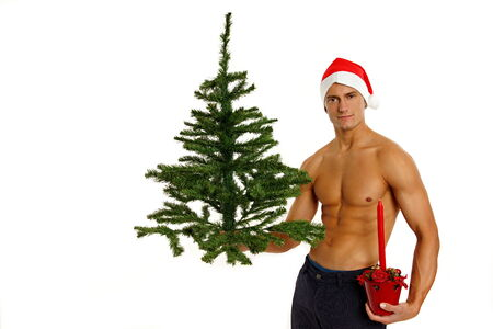 Atletic Santa Claus holds and shows christmas tree photo