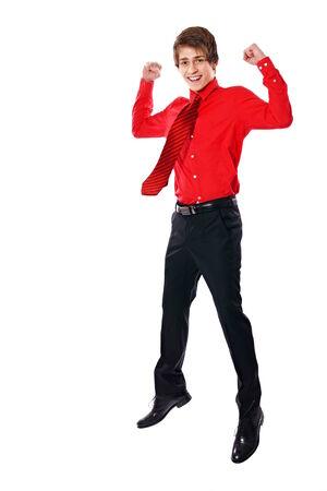 first rate 922f0 a3c41 Giovane imprenditore felice in camicia rossa salta su e dice sì