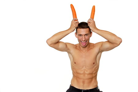 Young man with horns on his head from carrots photo