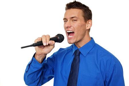 Karaoke with young businessman in blue shirt  Standard-Bild