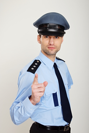 Police man shows with his finger on you