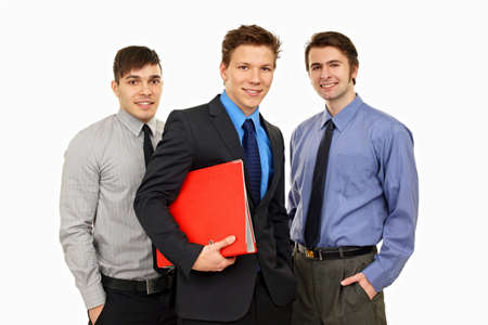worktops:                                Image of three business people with wortops on isolated background Stock Photo