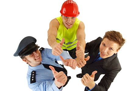 Portrait of three people - worker, police man and businessman shows thumbs up photo