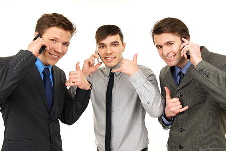 Three young happy men talks at mobile phone and shows call us