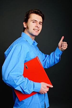 worktops: Young man at blue shirt holds worktops and shows you thumb up Stock Photo