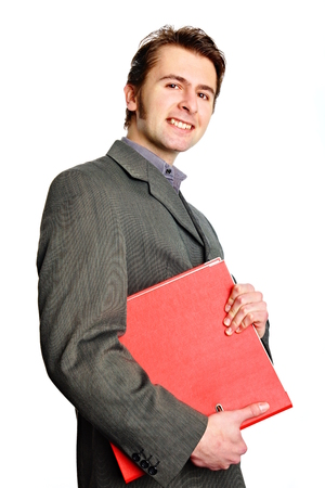 worktops: Angry young man in gray suit holds worktops on isolated background